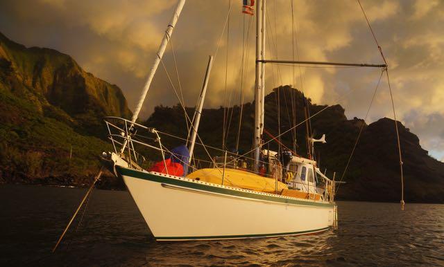 Kandu's boat swing at sunset in Vaitahu, Tahuata, Marquesas.