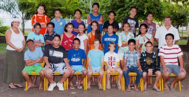 "Trent's class photo with the ubiquitious ""bird"" captured in this Kodak moment, the student at the front-left corner."
