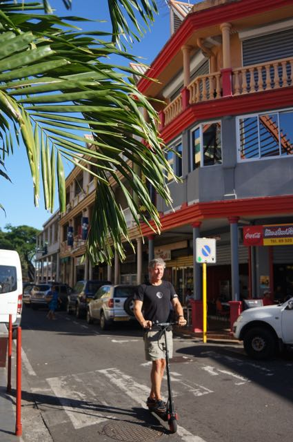 Eric scooting around the center of Papeete on Bryce's EcoReco Electric scooter