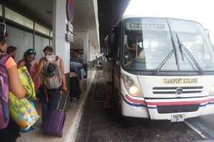 Loading onto the bus in Papeete.