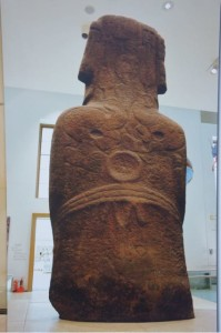 Moai that resides in London with bird man petroglyphs carved on his back.